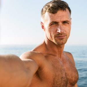 Handsome Shirtless Man on Beach